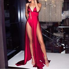 A very sexy long & bold dress which will make you dominate wherever you go! - Size runs slightly small, order one size up. - Model is wearing S size. - Material: Polyester, Silk. - Skinny fit - V-Neck - Open Skirt