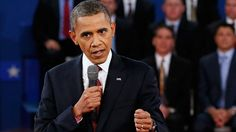 #148 Oct. 17-Obama and Romney Hit Swing States After Bruising Debate;President Barack Obama answers a question during the second presidential debate at Hofstra University on Oct. 16, 2012, in Hempstead, N.Y. (Rick Wilking/AP Photo)