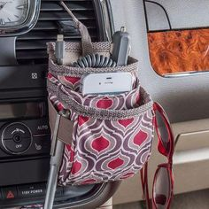 An air vent cell phone organizer with extra storage for charging cords pens, sunglasses and more. The High Road DriverPockets is now available in our exclusive Sahara pattern. See more of the Sahara car organizer collection at www. Car Cell Phone Holder, Air Vent Phone Holder, Cell Phone Pouch, Smartphone Holder, Iphone Holder, Organizer Auto, Car Organizers, Pochette Diy, Crochet Phone Cases