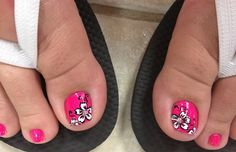 Pedicure with Solid, Bright pink toes, white with black detail outline hibiscus flowers, free hand floral toe nail art