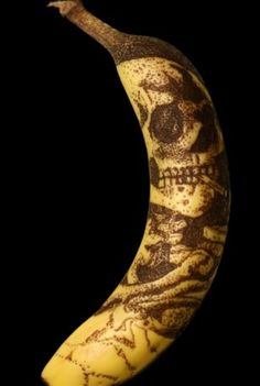 Van Gogh's smoking skeleton / skull smoking a Banana , BUT an artist re- created image by etching image into a Banana skin !! ( bit random - probably had the old tune stuck in his head - you know the one = Banana - na - boo - boo - be - doo - doo - Banana - na - boo - doo - doo - doo ......