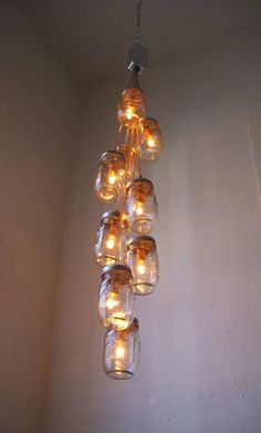 Comets Tail Mason Jar Chandelier - Mason Jar Lighting - Swag Lamp Handcrafted Upcycled BootsNGus Hanging Pendant Light Fixture via Etsy Pint Mason Jars, Ball Mason Jars, Mason Jar Chandelier, Mason Jar Lighting, Blue Velvet Chairs, Co Working, Jar Lights, Porch Lighting, Hanging Pendants