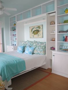 Murphy bed. Note lighting above, art on wall - moved from panel on outside when bed is closed. Note detail of side shelves and storage cabinets