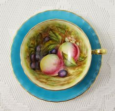 Blue Aynsley Tea Cup and Saucer with Hand Painted Fruit Center, Signed by Artist…