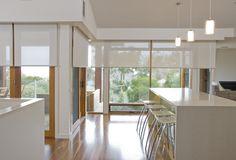 Roller blinds - neutral with floor boards. Hidden behind wooden frames.