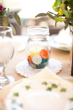 super simple and easy diy button centerpieces #buttonwedding #diycenterpieces #masonjar http://www.weddingchicks.com/2013/11/08/family-style-wedding-2/