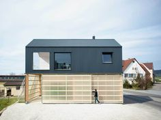 House Unimog in Germany features living quarters stacked on top of a translucent garage. See more at http://humble-homes.com/house-unimog-combines-simplicity-structure/