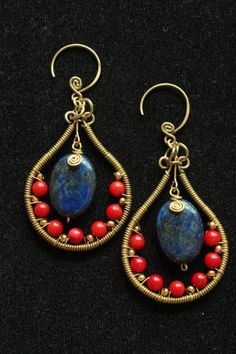 Brightening red coral is a perfect match color to the lapis lazuli. They have been hand wired around the bottom part of the earrings together with