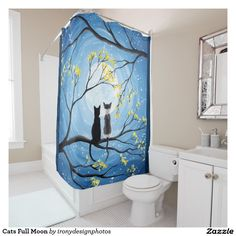 Cats Full Moon Shower Curtains. Two cats sitting on a branch watching the full moon with a blue sky filled with stars. The branches of the trees surrounding them with small yellow flowers. Black tuxedo cat and a bi-color white and grey spotted cat. Original Modern Acrylic Painting by Donna Leger. All Rights Reserved. ©irony designs