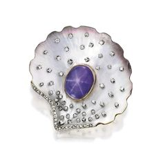18 KARAT TWO-COLOR GOLD, ABALONE, STAR SAPPHIRE AND DIAMOND CLIP-BROOCH, FRANCE Designed as an abalone seashell centered by a purple star sapphire measuring approximately 18.8 by 15.1 mm, decorated with round and rose-cut diamonds weighing approximately 1.35 carats, with French assay and workshop marks.
