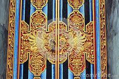 Mystical animals on Bali temple door detail by Thomas Jenkins, via Dreamstime