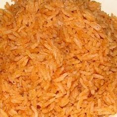 Restaurant Spanish Rice  3 tablespoons vegetable oil 1 cup uncooked long-grain rice 1 teaspoon garlic salt 1/2 teaspoon ground cumin 1/4 cup chopped onion 1/2 cup tomato sauce 2 cups chicken broth
