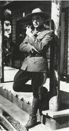 Original, vintage candid photo of Nelson Eddy on the set of Rose Marie(1936) and he is looking directly into the camera. This is a bit different from another one where he has a faraway look. - ESCANO COLLECTION