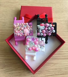 Pink, Black and White Phone Buddy's with Hello Kitty, bows, flowers and gems. Why not create your own at www.phone-buddy.co.uk Create Your Own, Create Yourself, Pink Black, Black And White, Hello Kitty, Gems, Gift Wrapping, Phone, Flowers