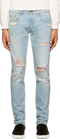 Slim-fit jeans in light blue. Fading and distressing throughout. Five-pocket styling. Embroidered logo at back pocket. Contrast stitching in tan. Zip-fly.<br><br>Part of the Rag & Bone x Christopher Milton collaboration.<br><br>