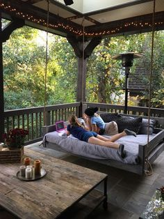 Why would you ever go inside with an outdoor living space like this? Porch bed swing.