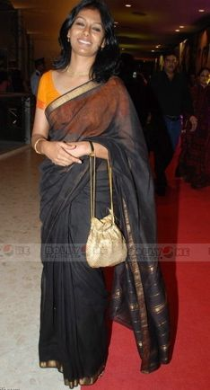 Nandita in a sheer black handloom saree with yellow blouse