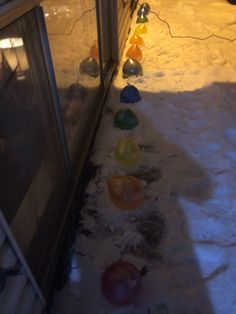 I managed to get the water balloons out of my Edmonton apartment without breaking any of them (here's a tip; put the food coloring in the balloon BEFORE putting the water in, also keep track of how much you put in each balloon so they're all the same and use WAY more than you think you'll need so they look the colour you want when frozen.