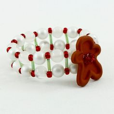 Items similar to Gingerbread Man Napkin Rings, Red White and Green Handmade Napkin Rings, Napkin Holders, Gingerbread Decor, Christmas Decorations - Set of 4 on Etsy All Things Christmas, Christmas Crafts, Christmas Decorations, Christmas Ornaments, Diy Crafts Jewelry, Diy Crafts For Gifts, Christmas Napkin Rings, Beaded Napkin Rings, Navidad Diy
