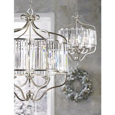 Illuminate your decor with this transitional antique soft silver and crystal chandelier from the Vienna Full Spectrum collection of pendants.