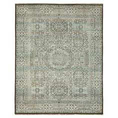 An allover stylized pattern of medallions and angular motifs emerges from a saturated slate and mint green field on this one-of-a-kind rug from the Veda collection. Hand-knotted in Pakistan from a wool blend, this rug is a cross-pollination of aesthetics, revealing an amalgam of cultural influences on the weaver who created it. Subtle variations in technique result in a unique tactile experience, no two pieces are alike.