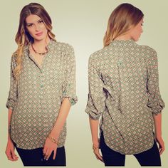 Green geo squares print chiffon top This lightweight woven top features a geo squares print. Split neckline with folded sleeve with buttoned tabs. Box pleated back yoke with curved hem. 100% polyester Tops