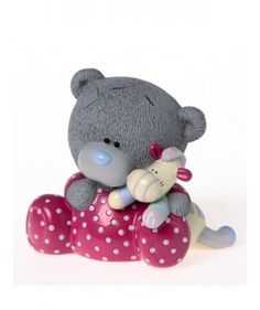 Let Tiny Tatty Teddy encourage good habits from day one with the adorable Tiny Tatty Teddy shaped money box. Perfect for both boys and girls with this neutral and classi design. Tiny Tatty Teddy is sat in his red spotty baby grow snuggling his toy giraffe.
