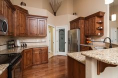 Craftsman Kitchen with Ms international  giallo ornamental granite, Limestone Tile, Stone Tile, High ceiling, French doors