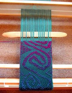 """lisa-rayner: I've had questions on exactly how I am making my freeform overshot mermaid scarf from people who belong to the Facebook Rigid Heddle Weaving group such as, """"do you use your pickup stick (in the Netherlands we call it pattern stick) in front of the heddle of at the back of it? And do you use the stick in a closed shed?""""How I am weaving freeform overshot on my Flip rigid heddle loom:With the heddle in the neutral (closed shed) position, use the pick up stick (also called a…"""