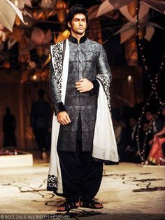 Dapper looking Namit Khanna showcases a creation by designer Rohit Bal during the grand finale of India Bridal Fashion Week '13, held at Grand Hyatt, in Mumbai.