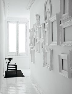 White frames on a white wall add great texture