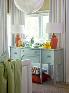 Light pastels are accented with tangerine via Tobi Fairley