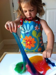 SLIME: 1 1/2 cups of CLEAR glue + 1 1/2 cups of liquid starch + couple drops of food coloring