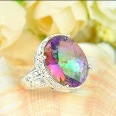 Oval Rainbow Mystic Fire Topaz Ring Sterling Silver Oval Rainbow Mystic Fire Topaz Ring.  Stone Size: 16x13 mm. Ring size: 8 Jewelry Rings