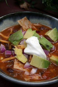 "Vegetarian Tortilla Soup - 1½ t. cumin  1 t. chili powder  ½ t. garlic powder  ½ t. salt  1 T. olive oil  1 c. diced onion  ½ c. diced red bell pepper  3 cloves garlic, minced  1 can (10 Oz. Can) Rotel tomatoes and green chilies  32 oz. (4 c.) low sodium vegetable stock  3 T. tomato paste  4 cups hot water  2 cans (15 Oz. Can) black beans, drained and rinsed  ½ c. frozen corn  3 T. cornmeal  5 corn tortillas, cut into 2-3"" strips"