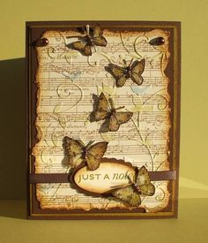 love the butterflies...and the embossing of the sheet music paper