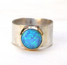 Blue Opal Ring - Silver Ring and 14k Gold Ring Statement ring,Cocktail ring opal stone MADE TO ORDER by OritNaar on Etsy https://www.etsy.com/listing/130739992/blue-opal-ring-silver-ring-and-14k-gold