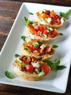 Caprese Salsa Fresca Bruschetta...Summer's favorite salad becomes a fresh and crunchy salsa served on garlic-rubbed baguette slices!!