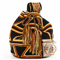 Cute black Mochila bag for fall. The average bag takes 5-7 days to hand weave. All bags are Handmade. Wayuu people are use bight different colors and patterns to tell the story of the weaver. These are all one-of-kind bags. Wayuu tribe bags are $75.00. They are woven with cotton thread. A nice beach bag or farmer bag that is very sturdy. www.wayuutribe.com #mochila #bohochic #surferchic #surfergirl