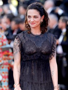 """Asia Argento attends the """"Ismael's Ghosts (Les Fantomes d'Ismael)"""" screening and Opening Gala during the annual Cannes Film Festival at Palais des Festivals on May 2017 in Cannes, France. White Top And Blue Jeans, White Tops, Stephane Audran, Asia Argento, Palais Des Festivals, Michelle Rodriguez, Italian Actress, Jessica Alba, Cannes Film Festival"""