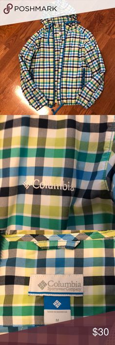 Columbia rain coat-women's Blues and greens plaid rain coat. Has a good and zippered pockets. EUC Columbia Jackets & Coats