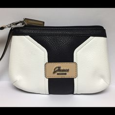 """⚡️FLASH SALE!⚡️GUESS BLACK & WHITE WRISTLET GUESS BELVEDERE WRISTLET CLUTCH PURSE  ~NEW WITH TAG~  STYLE: VY637853  COLOR: BLACK MULTI  ZIPPER CLOSE TOP """"GUESS""""  ON THE FRONT SILVER HARDWARE INTERIOR LINING  INSIDE SLIP TAN WRIST STRAP 5.5'' MEASUREMENTS: 7.25'' X 4.50"""" X 1"""" Guess Bags Clutches & Wristlets"""
