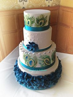 Peacock themed wedding cake. Handpainted