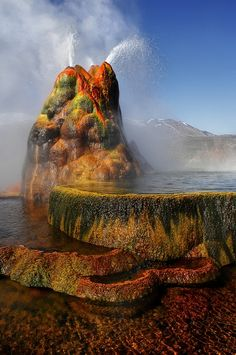 Unbelievable Places-Fly Geyser, Nevada, manmade and created by accident. In 1912 a geothermal well was drilled and in 1960 geothermally heated water found a crack and erupted, it's been spewing hot water up to 5' high ever since, growing and forming from the dissolved minerals that accumulate, hence the beautiful colors.