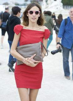 Alexa Chung wearing Valentino clutch. Shop Valentino at MATCHESFASHION.COM #MATCHESFASHION