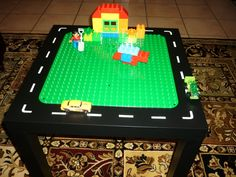 homemade lego -  Made from a cheapo IKEA table, a Duplo Lego Board and the white part that surrounds a sheet of stickers!