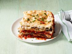 This lasagna recipe from Bobby Flay and Food Network Magazine is more than just another pretty plate. Packed with wild mushrooms and cauliflower, it has all the goodness of vegetables with all the flavor of your favorite comfort food. #FNMag