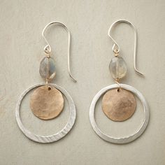 "LUNAR ORBIT EARRINGS -- In these handmade labradorite and sterling hoop earrings, sterling silver hoops orbit moon-like disks handcrafted of 14kt gold filled beneath the heavenly iridescence of labradorites. French wires. Handcrafted in USA. 1-7/8""L."