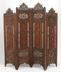 Moorish style carved and pierced teak 4 fold screen with floral filigree design and 2 tall center panels Price $4,250.00