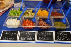 Hot dog toppings bar. Perfect for your 4th of July party! Create your own buffet table labels with mini chalkboard signs.